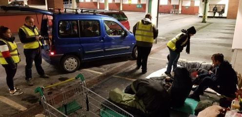 Community Spirit volunteers feeding homeless people at Morrisons car park in Blackburn town centre