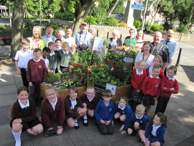 Barnoldswick in Bloom members with volunteers and primary school children