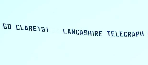 ON A HIGH: The banner saying 'Go Clarets – Lancashire Telegraph' flies over Turf Moor in the plane
