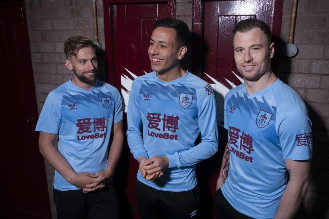 Charlie Taylor, Dwight McNeil and Ashley Barnes show off Burnley's new away kit