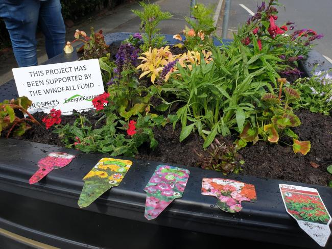 £1,800 has been used to fund colourful planters brightening up Oswaldtwistle and Knuzden