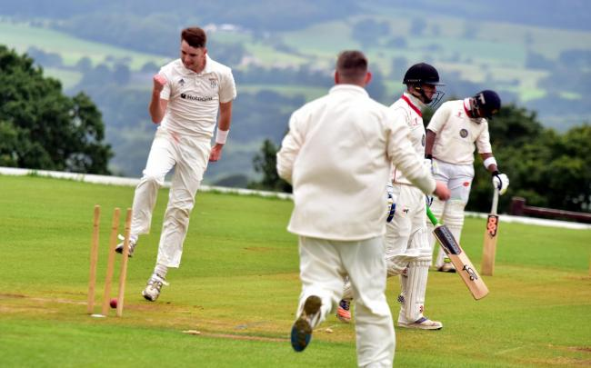 Jonathan Beech of Barnoldswick celebrates taking the wicket of Liam Parkinson of Salesbury