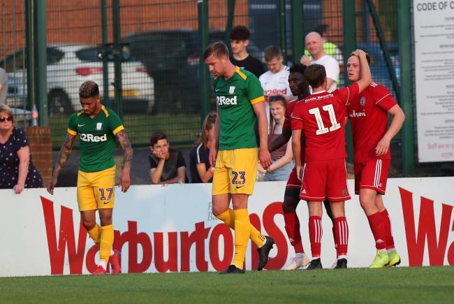 Colby Bishop in congratulated by Stanley teammates after scoring against Preston at the County Ground, Leyland last night