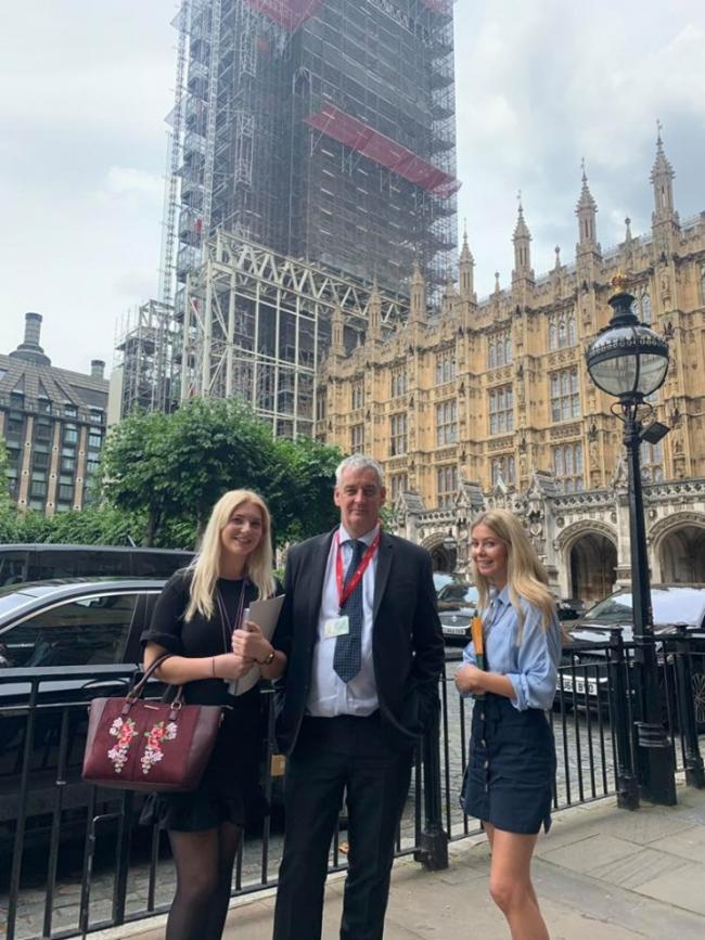Abbie Melvin (left) and Isabelle Reed with Graham Jones at Westminster
