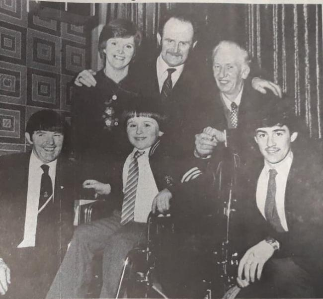 Seamus McLaughlin hands over the electric wheelchair to Frank Larkin. Frank's parents Frank and Brighidn (back row), and Jeff Turnball and James Green who accompanied Seamus on his run to Manchester