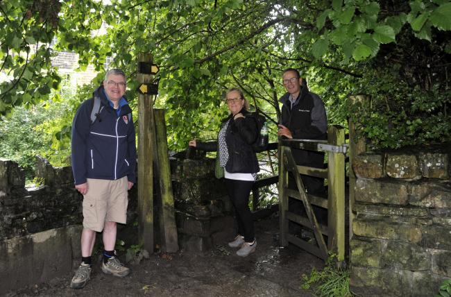 from left, Mike Williams, tourism officer, Angela White, operations manager at Pendle Heritage Centre and Tom Partridge, Pendle countryside access officer as they celebrate the 400th anniversary of Jonas Moore and the 30th anniversary of the Pendle walkin