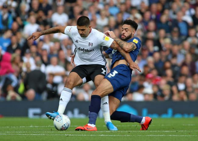 Derrick Williams challenges Aleksandr Mitrovic in Rovers' defeat at Fulham