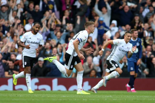 Tom Cairney celebrates opening the scoring for Fulham against Rovers