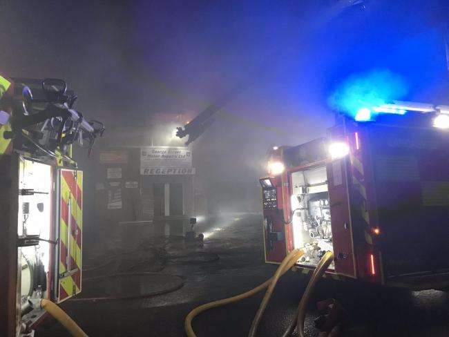 Firefighters battling the flames at a garage in George Street, Chorley. Picture credit Shaun Walton