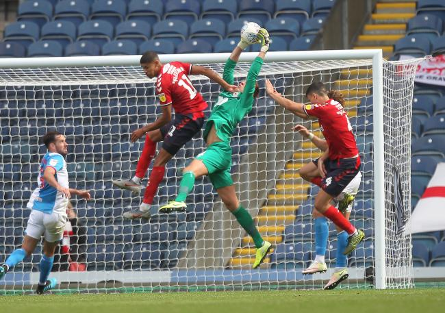 Rovers 'keeper Christian Walton claims a high ball