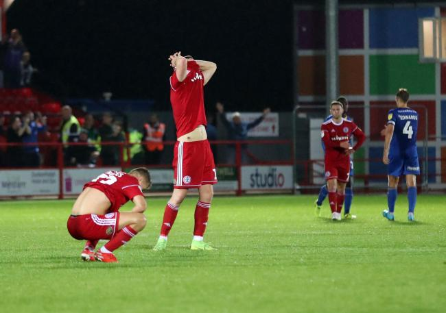 Accrington Stanley's players devastated at the final whistle after losing from 2-0 up