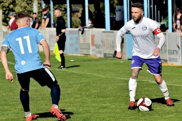 Tom Kennedy looks to set up another attack for Ramsbottom United against Ossett United