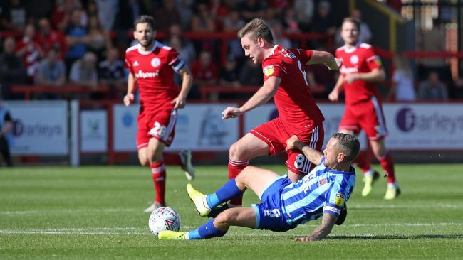 Sam Finley in the thick of the action against Blackpool. Picture: KIPAX