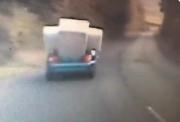 Police officers filmed this car driving with a bed hanging out the boot