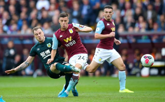 Ashley Barnes in the thick of the action at Villa Park