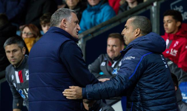 The two managers, Tony Mowbray and Sabri Lamouchi, share a handshake pre-match