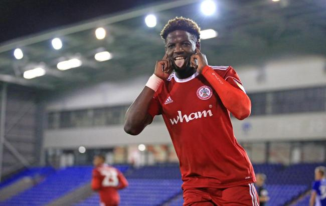 Offrande Zanzala celebrates after scoring a penalty in the win over Oldham Athletic