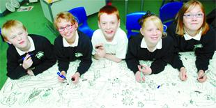 BIG DRAW: Adding to the doodle are Pendle Vale Community School pupils, from left, John Knowles, Faye McNeilly, Elliot Allen, Georgia Strachan, and Lyndsey Sterratt