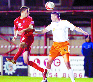 RISING HIGH: Michael Symes heads for goal during last night's Crewe clash.       Pic: KIPAX