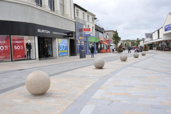 St James Street and Parker Lane in Burnley town centre where work continues improving the paving for the town centre.