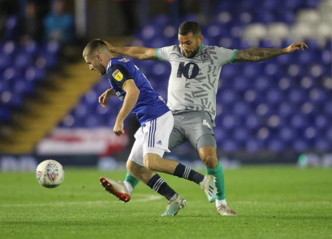 Bradley Johnson puts in a challenge during Rovers' defeat at Birmingham City