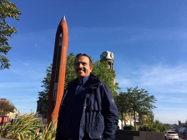 Cllr Iqbal at the Shuttle sculpture