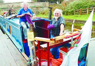 BRISK TRADE: Carole and Colin Wareing aboard Patty Ann on the Leeds and Liverpool canal near Barden Mill, Burnley