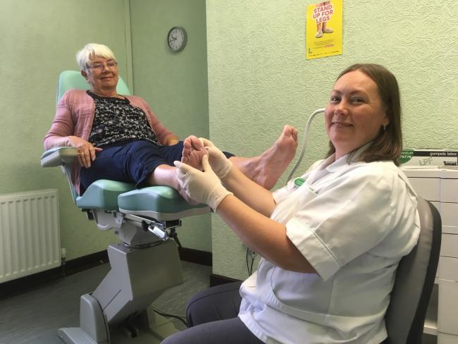 Podiatrist Catherine Adams, and patient Marie Sanderson
