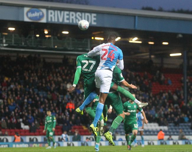 Tosin Adarabioyo heads in the equaliser for Rovers against Sheffield Wednesday