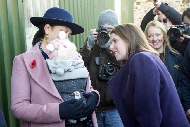 Jo Swinson meets Daphne Grint, aged 5 months, and her mother Rebecca Bell during a visit to Crafty Maltsters at Demperston Farm, Auctermuchty (Lesley Martin/PA)