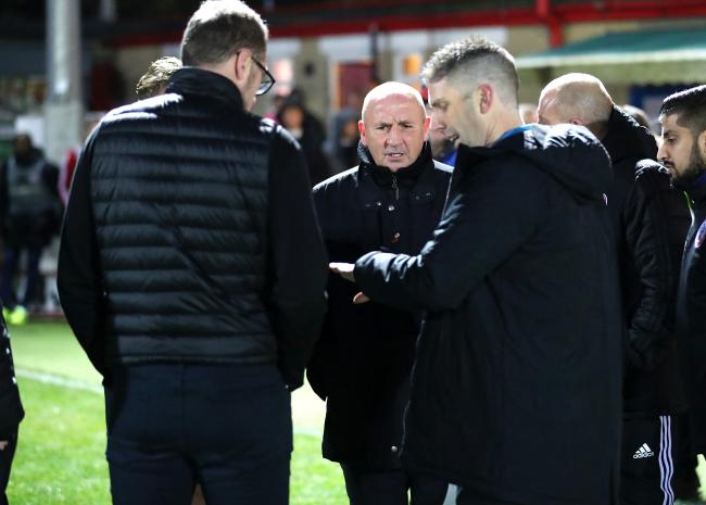 John Coleman can't hide his bemusement as referee Neil Hair tosses a coin to decide who gets a linesman. Picture: KIPAX