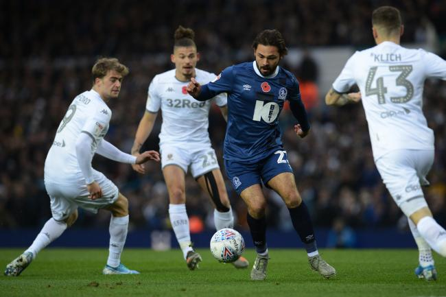 Bradley Dack is crowded out during Rovers' defeat at Leeds United