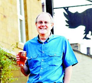 MINE HOST: John Ingham raises a toast to the future at the Rising Sun