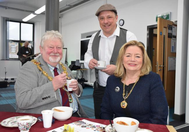 LAL's Partnership and Recruitment Officer Neil Morley enjoying a cup of tea and a Lancashire snack with the Mayor and Mayoress of Pendle at last year's celebration.