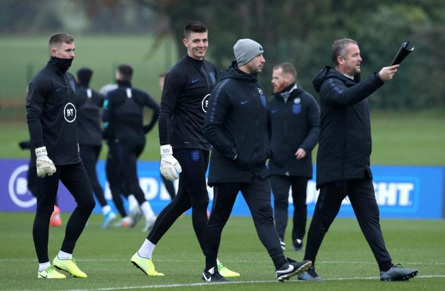 Nick Pope, centre, in England training