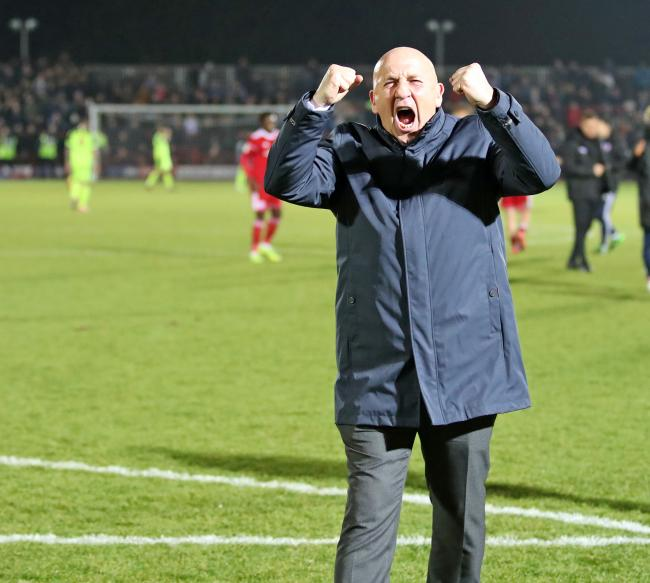 John Coleman celebrates in front of the Clayton End at the final whistle in the win over Bolton