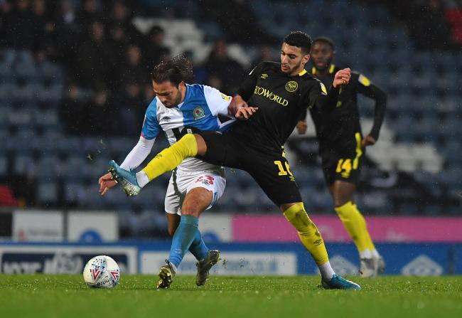 Bradley Dack battles with Said Benhrama
