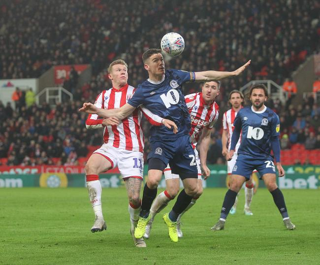 Darragh Lenihan clears the danger during Rovers' win at Stoke City