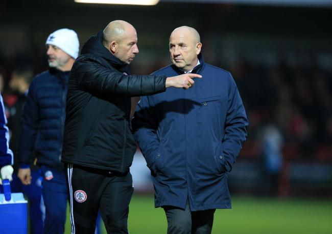 jimmy bell and john coleman leaving the pitch at half time