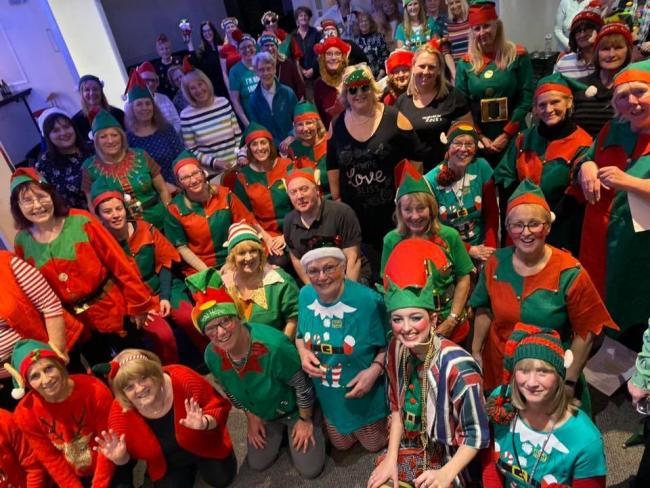 Preston, Chorley, Wigan and St Helen's Rock Choir dressed as elves and raising cash for Lancashire Mind