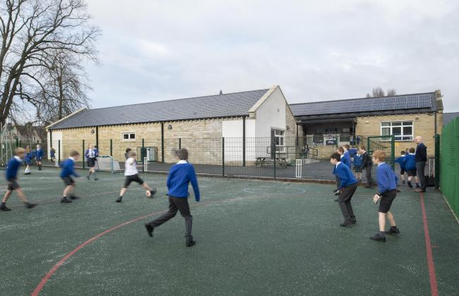 Youngsters enjoy the new games area at Whalley CE Primary School, which was built by ENGIE