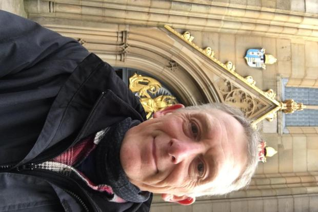 Rev. Jonathan Carmyllie outside the West Door of Blackburn Cathedral at the end of his pilgrimage