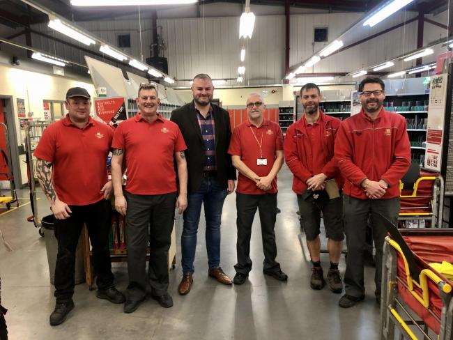 Andrew Stephenson with Royal Mail staff
