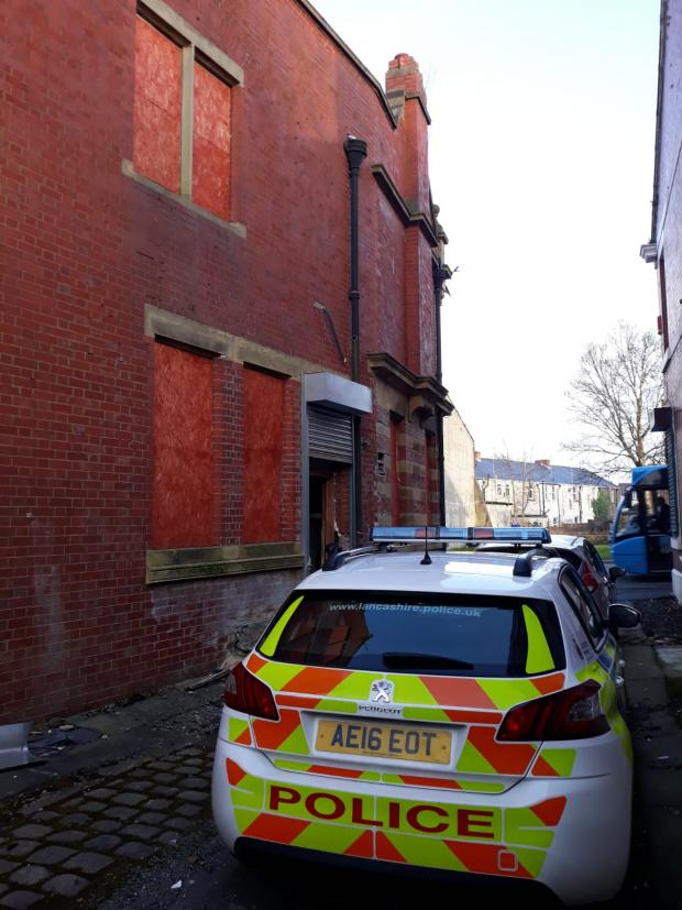 Lancashire Telegraph: A police car and an unmarked car guard the entrance