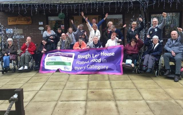 Staff and residents at Rough Lee Home in Accrington celebrating their good CQC rating