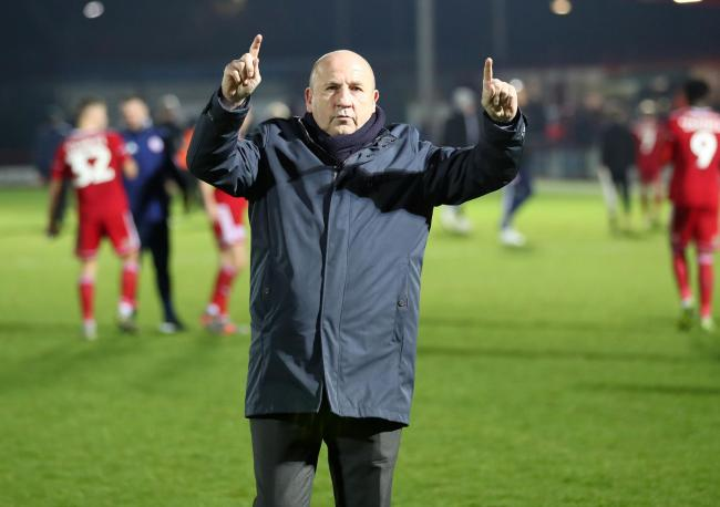 Accrington Stanley manager John Coleman celebrates in front of the Clayton End after Sunday's win over Burton Albion