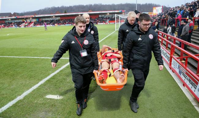 Sean McConville leaves the field on a stretcher. Picture: KIPAX