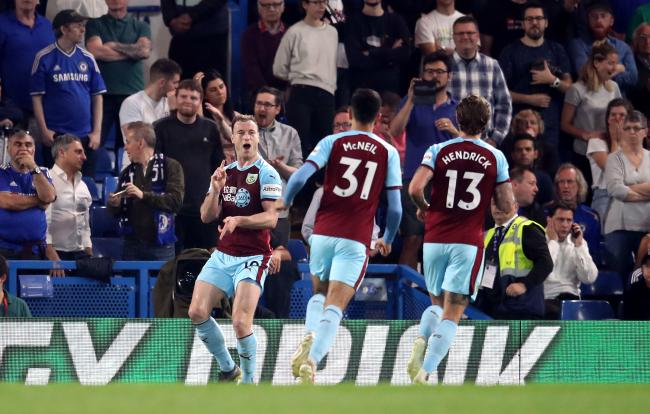 Ashley Barnes celebrates his goal at Chelsea in April
