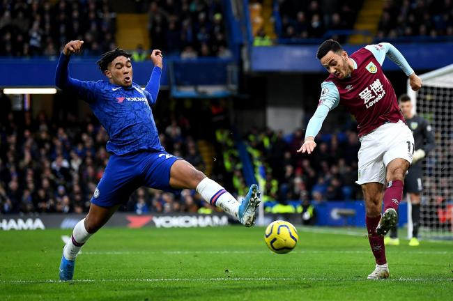 Dwight McNeil in action at Stamford Bridge