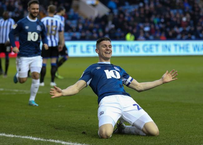 Darragh Lenihan celebrates putting Rovers 4-0 up at Sheffield Wednesday